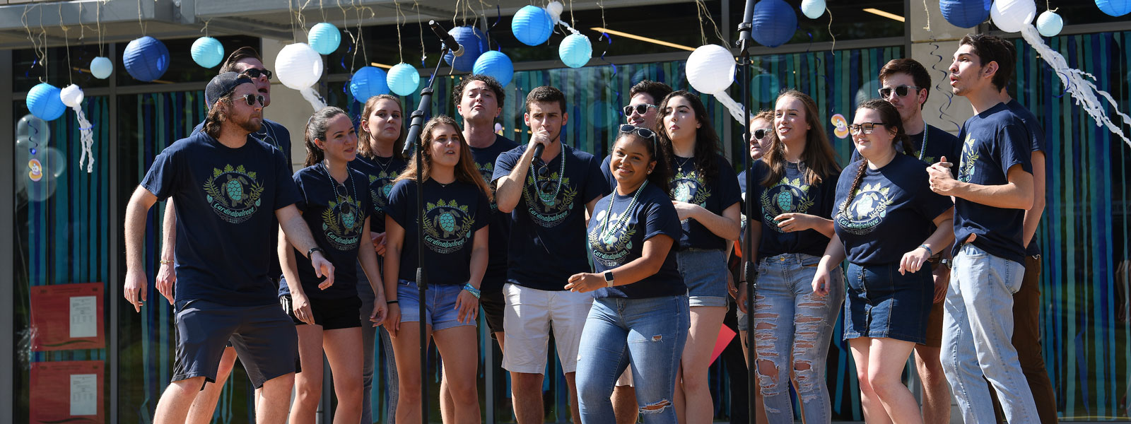 Group of students singing at end-of-year celebration